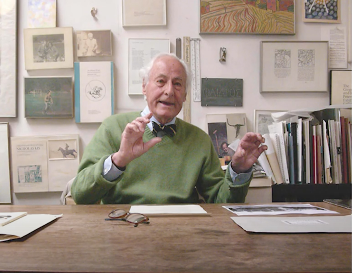 Image of Jack W. Stauffacher at his desk, gesticulating as he talks animatedly