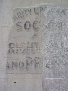 Faded signage from a wall in Brighton, England